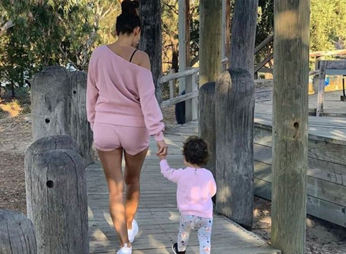 Snez walking with baby willow along the boardwalk