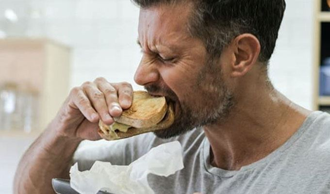 Sam eating a sandwich - carbs arent the enemy